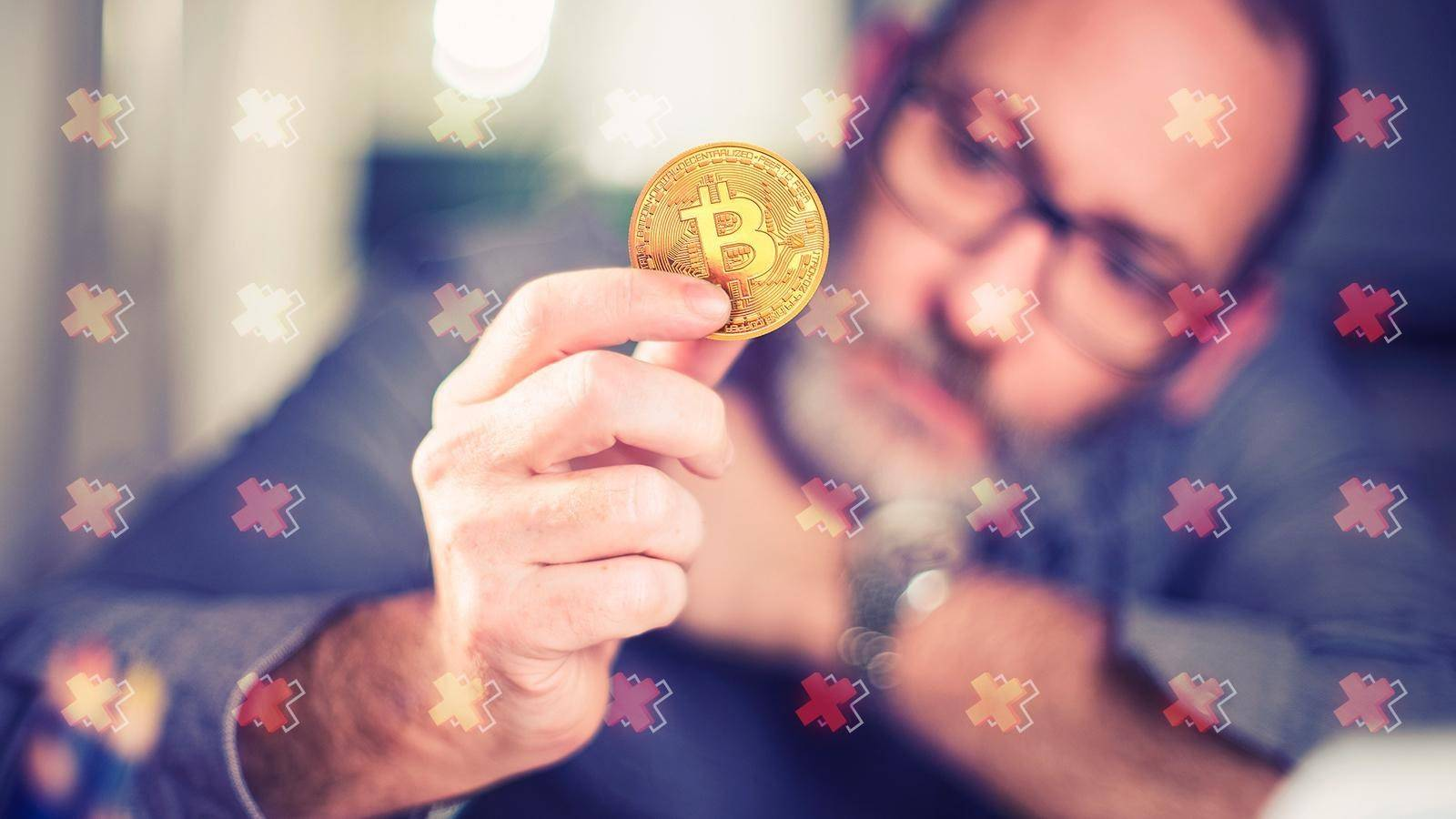 a man with a bitcoin coin